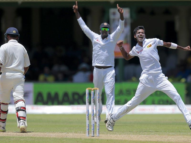 Sri Lanka's Dushmantha Chameera, right, celebrates the dismissal of India's Amit Mishra, left. (AP Photo)