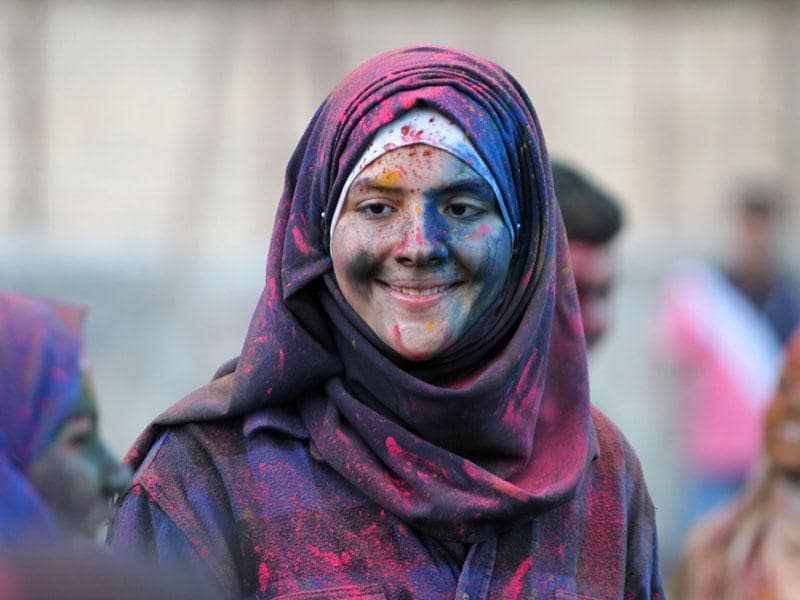 A Palestinian youth covered with coloured powder takes part in the Festival of Colours. (AFP Photo/ Abbas Momani)