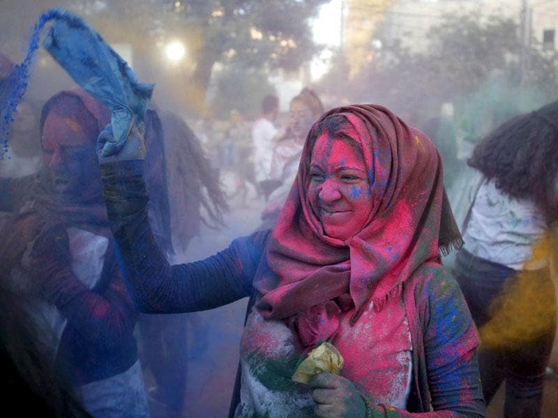 Inspired by the Hindu spring festival of Holi, Palestinians celebrate the Festival of Colours. A reveller takes part in the festival organized by Palestinian activists in the West Bank city of Ramallah on August 20, 2015. (Reuters/ Mohamad Torokman)