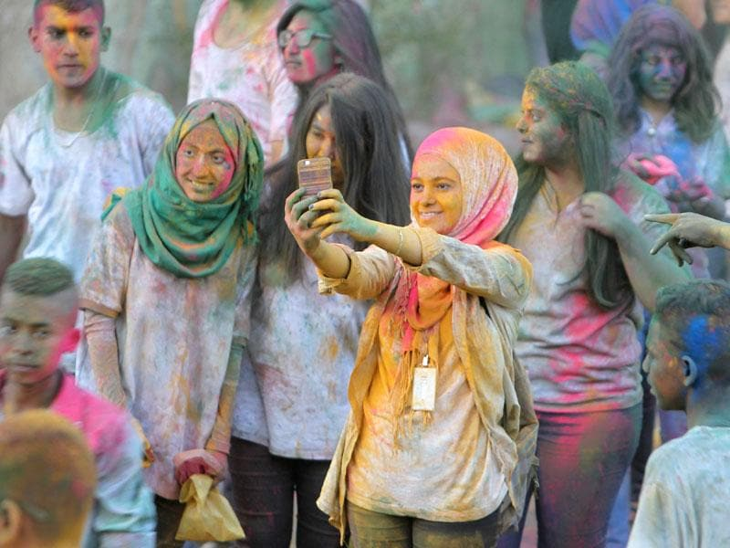 The war-torn city celebrated the Festival of Colours with fervour. (AFP Photo/ Abbas Momani)