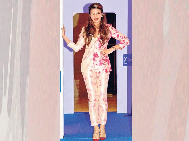Want to look flirty and playful? Go for a bright, printed pantsuit. Actor Jacqueline Fernandez goes for a neon pink printed number.