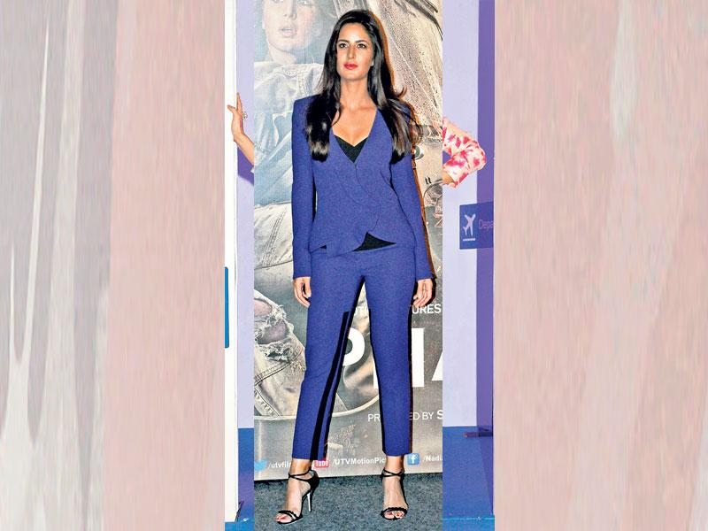 Colourblock your pantsuit while wearing a different huedtop underneath. Actor Katrina Kaif wears a blue suit with a black top.