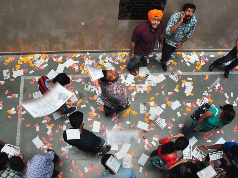 Students throwing their party pamphlets from the top floor of the Law Department, Panjab University. Karun Sharma/HT
