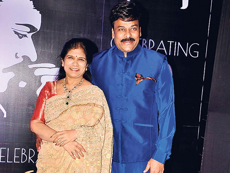 Chiranjeevi poses for the shutterbugs with wife Surekha Konidela at his birthday party. (Photo: Viral Bhayani)