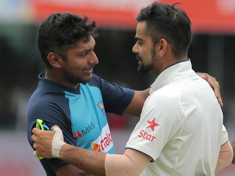 Sri Lanka's Kumar Sangakkara and India skipper Virat Kohli speak to each other after the second Test between Sri Lanka and India in Colombo on August 24, 2015. (AP Photo)