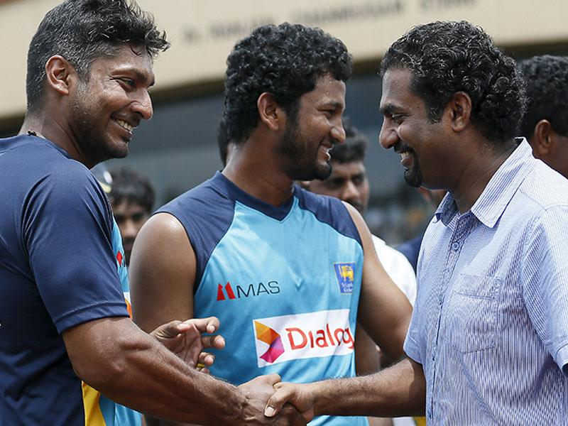 Sri Lanka's Kumar Sangakkara (left) shakes hands with former national teammate Muttiah Muralitharan (right) during Sangakkara's retirement ceremony. The second Test was the last of Sangakkara's international career. (Reuters Photo)