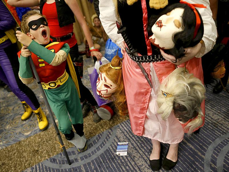#Aww. We've never seen a cuter Robin. The adorable hero yawns as he waits in line for the start of the costume contest at Wizard World Comic Con. (Reuters/ Jim Young)