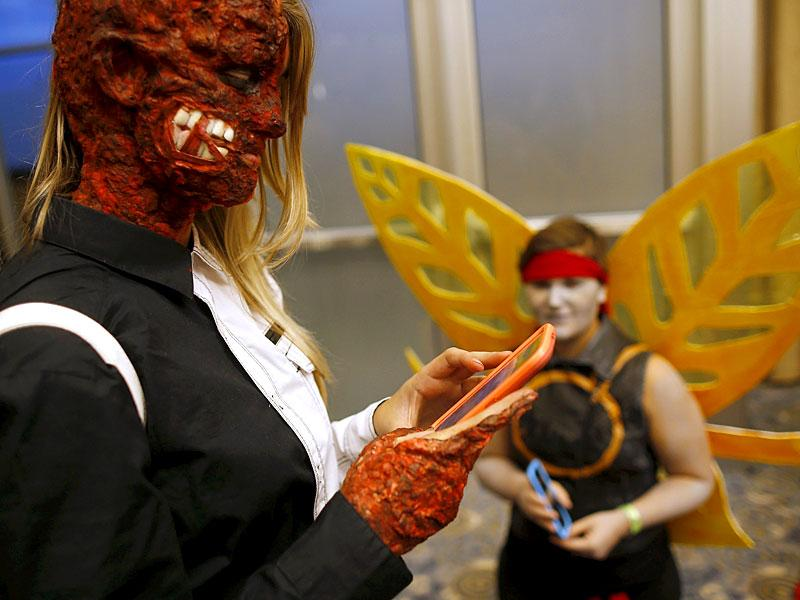 #Spooky. A contestant dresses as Two-Face totally gives us the creeps. (Reuters/ Jim Young)