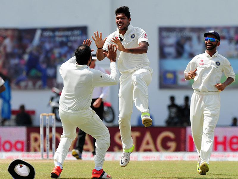 Umesh Yadav, centre, celebrates with teammates the dismissal of Sri Lankan captain Angelo Mathews. (AFP Photo)