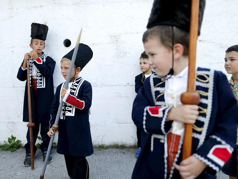 Alkar Vito (2nd left) prepares before the Children's Alka competition in Croatia. (Reuters)