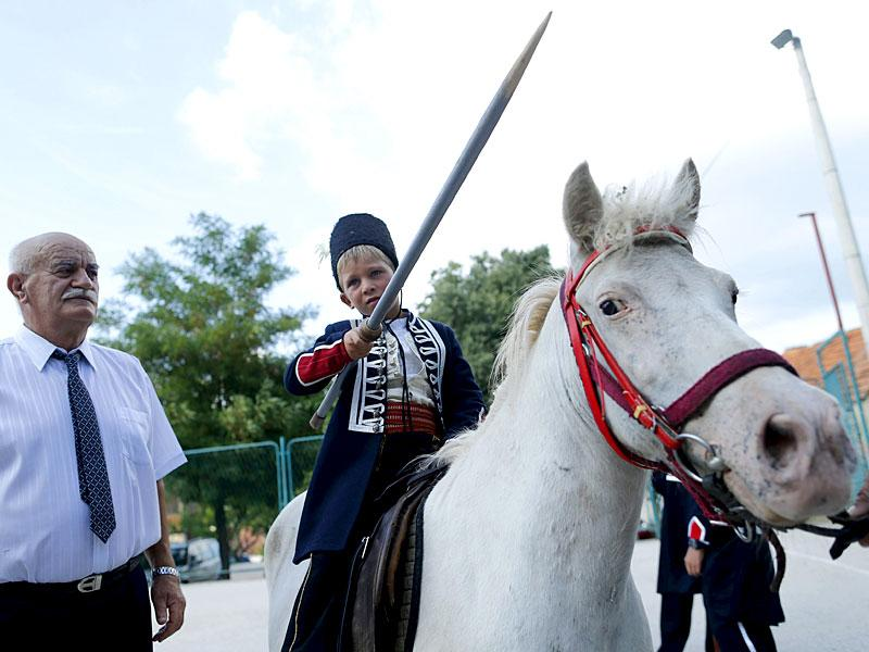 Alkar Vito poses for a picture on a horse before the Children's Alka competition in Croatia. (Reuters)