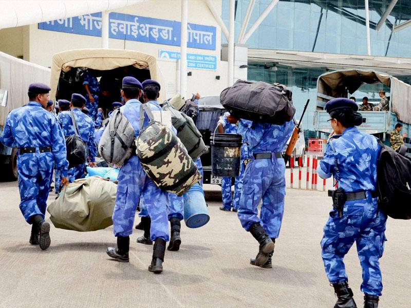The Rapid Action Force (RAF) personnel arrive in a special Indian Army plane to leave for Gujarat, at Raja Bhoj airport in Bhopal. Defence forces were called in as the Patel community's agitation intensified and spurred violence in several cities of the state. (PTI Photo)