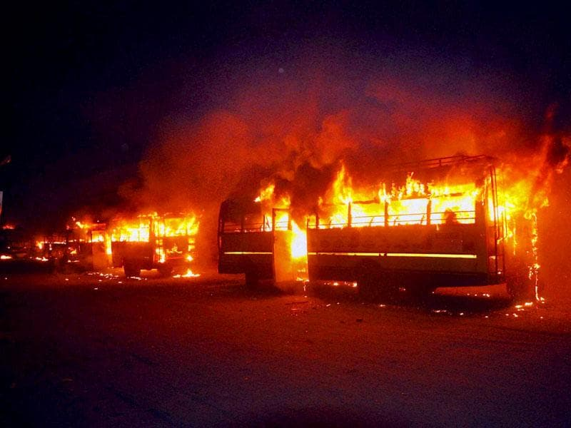 Buses set on fire in Surat as the Patel community was enraged after Hardik Patel, convener of Patidar Anamat Andolan Samiti, was detained on Tuesday. (PTI Photo)