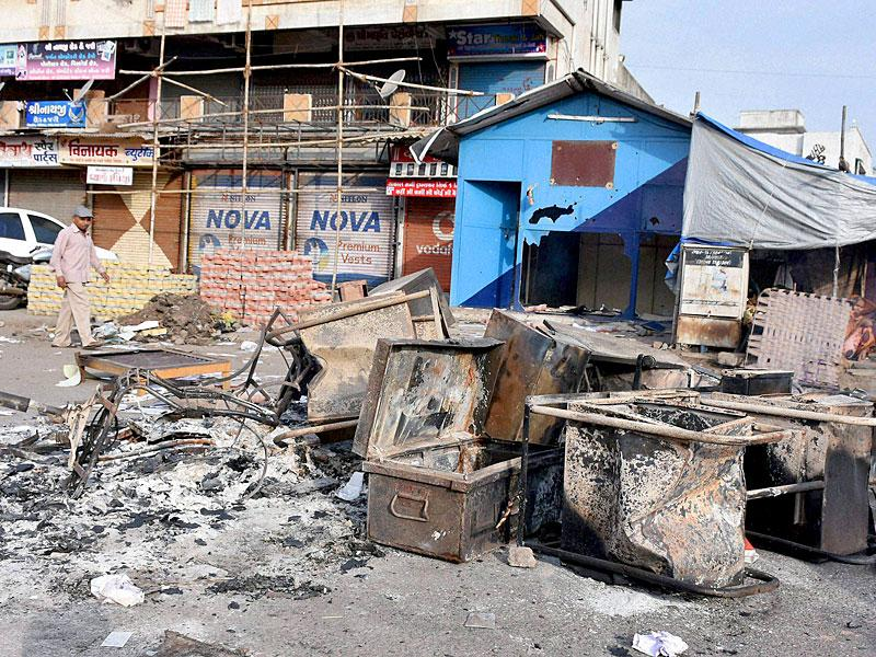 Furniture from a police post was set ablaze by supporters of Hardik Patel, convener of the Patidar Anamat Andolan Samiti, after his detention in Surat on Wednesday. (PTI Photo)