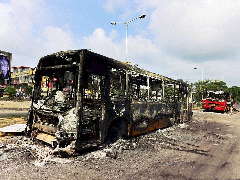The charred remains of buses in Ahmedabad on Wednesday which were set on fire during the Patidar community's agitation on Tuesday night. (PTI Photo)