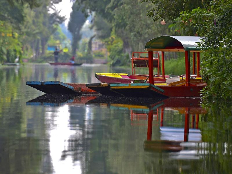 Xochimilco, 16 boroughs within Mexican Federal District, are home to hundreds of people who use 'trajineras' as transport. (AFP)
