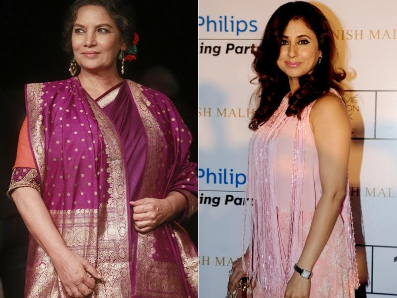 Shabana Azmi (L) poses for a photograph at LFW Winter/Festive 2015. Urmila Matondkar was also seen at the event. (AP Photo, AFP Photo)