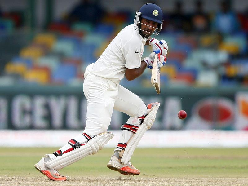 India's Cheteshwar Pujara plays a shot during the first session of play. (Reuters Photo)
