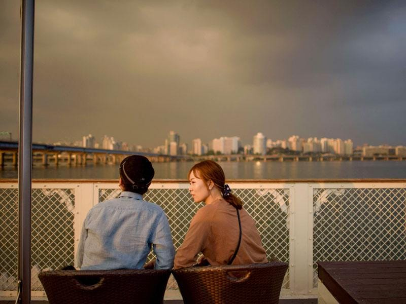 A couple sits on the deck of the tour boat. (AFP Photo)
