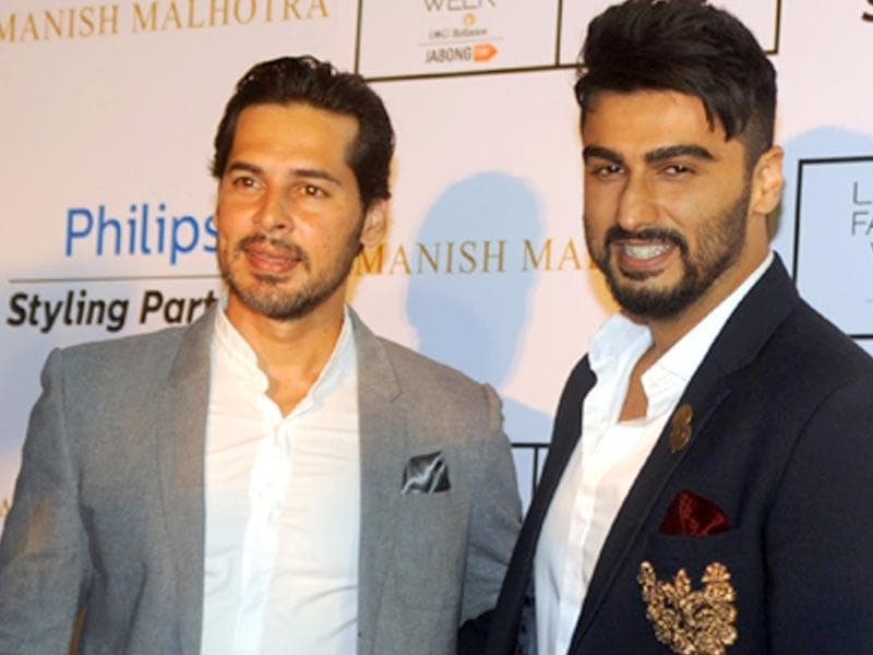Bollywood actors Dino Morea (L) and Arjun Kapoor pose for a photograph during LFW Winter/Festive 2015. (AFP Photo/ Sujit Jaiswal)