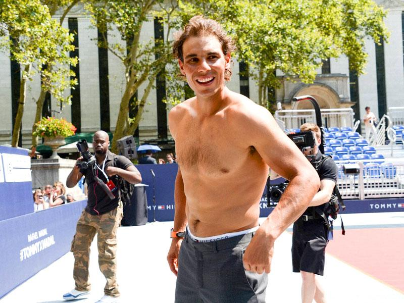 Nadal loses his shirt and suit by the time the event comes to an end. (AP Photo)