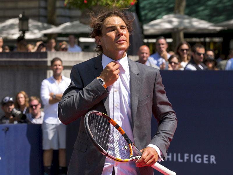 Nadal takes off his shirt while taking part in the strip tennis event to promote the launch of Tommy Hilfiger's new line of underwear. (Reuters Photo)