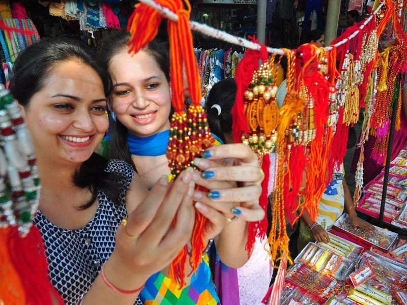 Two girls deciding which Rakhi to buy amongst all the choices. (Karun Sharma)