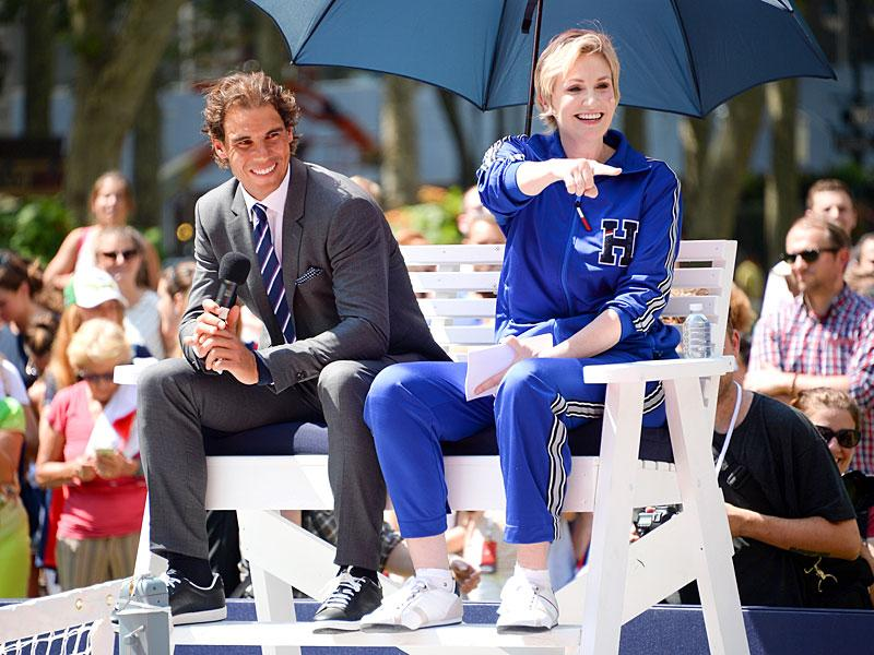 Spain's Rafael Nadal, left, and actress Jane Lynch participate in the Tommy Hilfiger promotional event at Bryant Park in New York City, on August 25, 2015. (AP Photo)