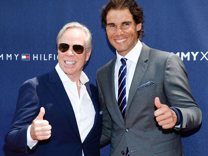 Fashion designer Tommy Hilfiger, left, and Nadal pose for the cameras prior to the start of the event. (AP Photo)