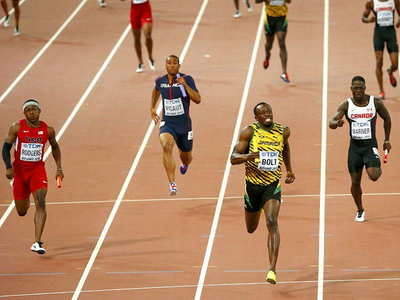 Bolt (C) competes in the men's 4 x 100 metres relay final. It was a record-extending 11th world gold for Bolt, who also won three sprint titles at the 2009 and 2013 world championships. (Reuters)