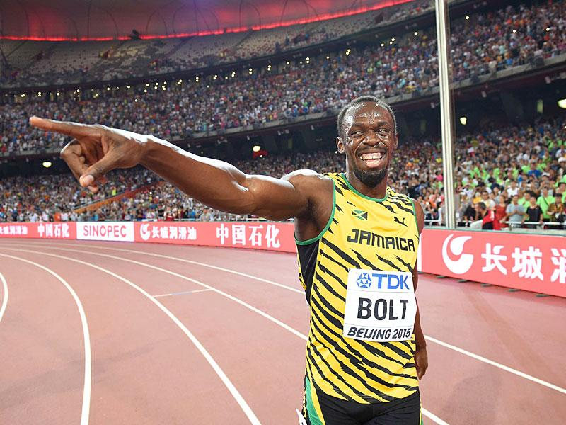 Bolt celebrates after anchoring the Jamaican team's victory in the final of the men's 4x100 metres relay. (AFP Photo)