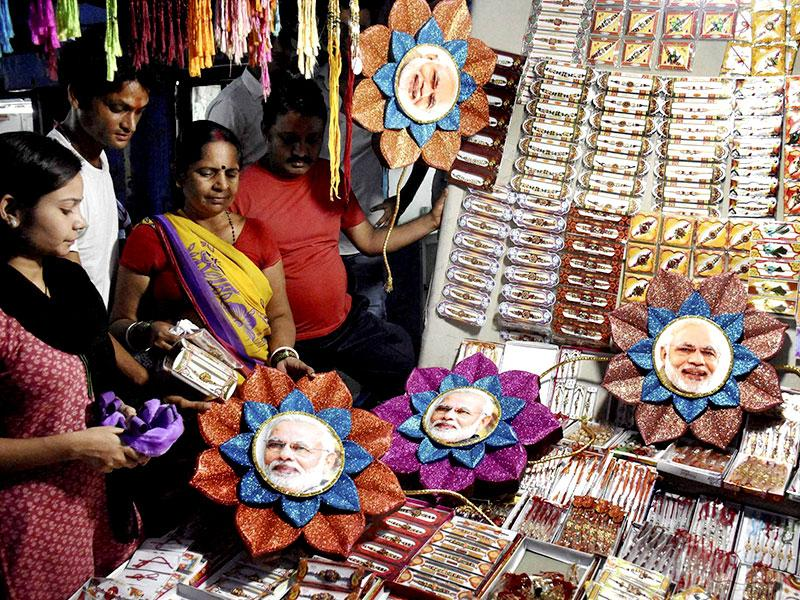 The latest and the coolest trend is of rakhis with pictures of Prime Minister Narendra Modi. (PTI Photo)