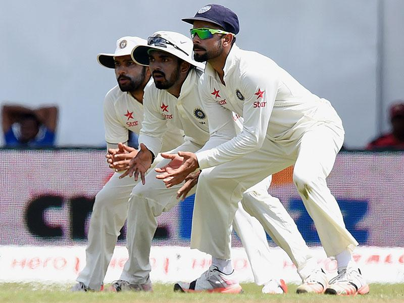 Kohli, right, Lokesh Rahul, centre, and Rohit Sharma field in the slip cordon. (AFP Photo)