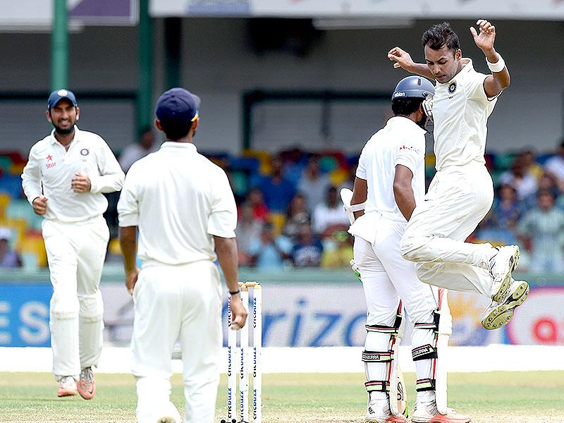 India's Stuart Binny, right, celebrates taking the wicket of Dinesh Chandimal, second from right. (AFP Photo)