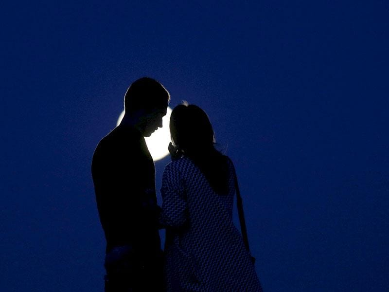 A young couple look at the super moon in the town of Novogrudok, 150 kilometers west of the capital Minsk, Belarus. (AP Photo)