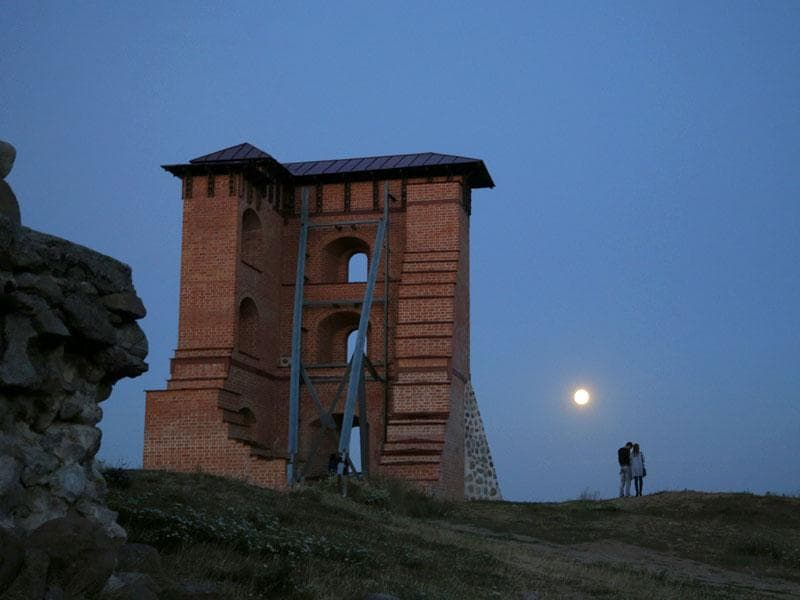 The supermoon rises above the remains of a medieval fortress in the town of Novogrudok. (AP Photo)