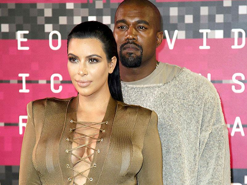Kim Kardashian and musician Kanye West kept their style statements simple. So that West could save the best for the stage: He said he's running for President in 2020, and that he smoked pot before coming on stage. (Reuters photo)