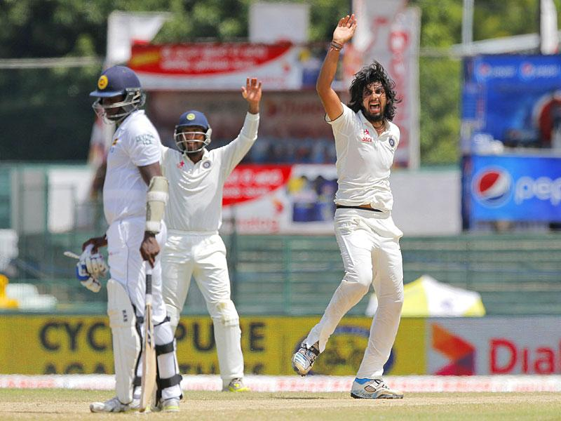 India's Ishant Sharma, right, unsuccessfully appeals for the wicket of Thirimanne, unseen, as Mathews, left, watches. (AP Photo)