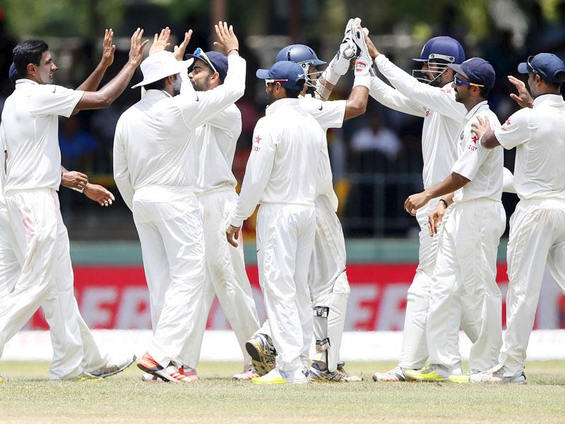 India's Ravichandran Ashwin, left, celebrates the dismissal of Thirimanne with teammates. (Reuters Photo)