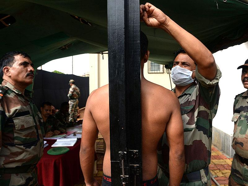 A youth stands as his height is measured at the army recruitment rally (AFP Photo)