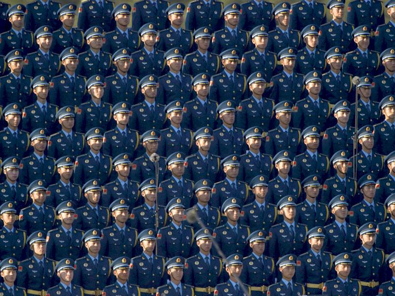 Soldiers of the People's Liberation Army (PLA) of China stand in formation as they gather ahead of the parade. (Reuters Photo)
