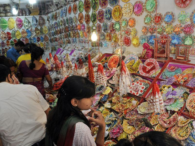 People having a look at Lord Krishna idols on display at a shop ahead of Janmashtami, in Bhopal on Thursday. (Praveen Bajpai/HT)
