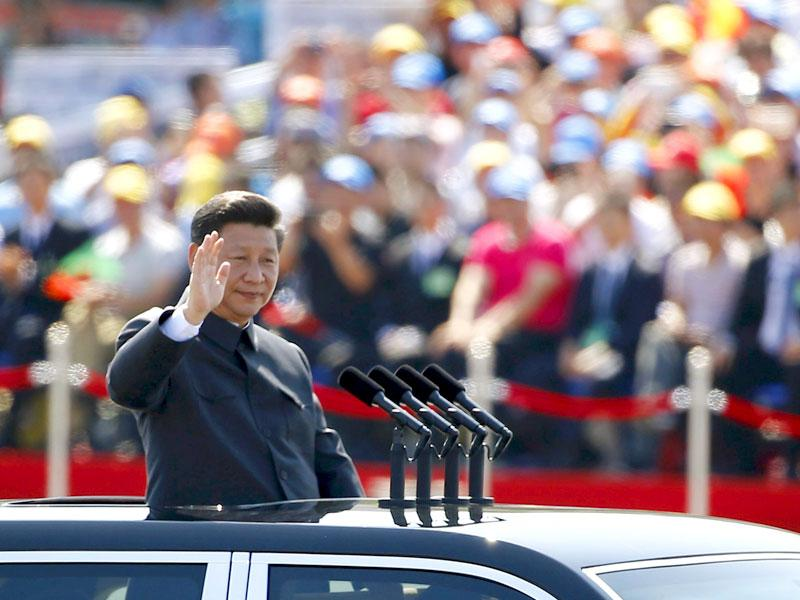 Chinese President Xi Jinping waves as he reviews the army, at the beginning of the parade. (Reuters Photo)