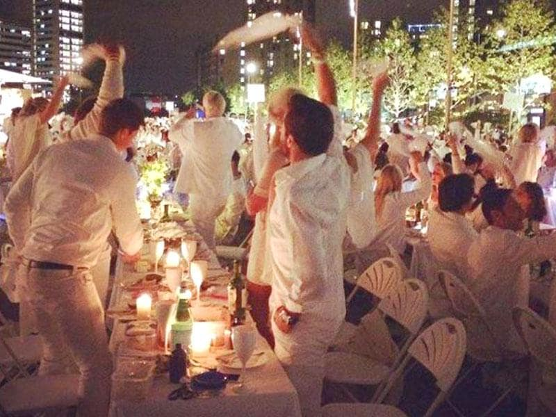 The tradition began 27 years ago in Paris, when organisers invited guests to wear all white in a park so they could be spotted easily.