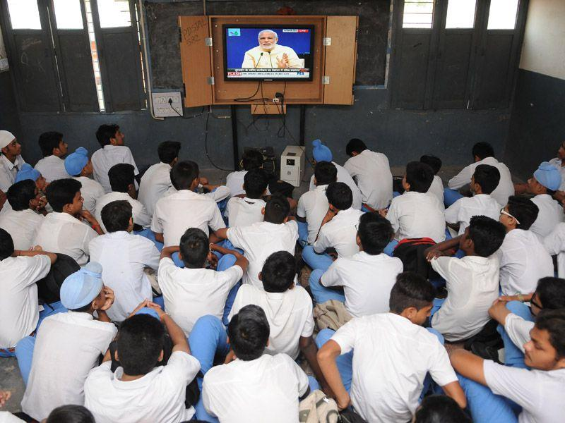 Students of Government Senior Secondary School, Ladowali listening to the PM's address, a day ahead of Teachers' Day on Friday. Pardeep Pandit/HT