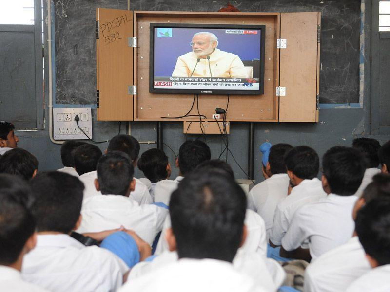 Students listening to Prime Minister Narendra Modi's 'Mann Ki Baat' programme at Government Senior Secondary School, Ladowali on Friday. Pardeep Pandit/HT
