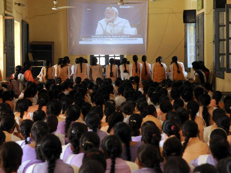 Students of Government Girls Senior Secondary School, Nehru Garden listening to Prime Minister Narendra Modi, a day ahead of Teachers' Day on Friday. Pardeep Pandit/ HT