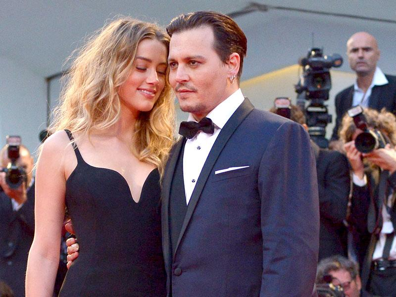 But Johnny Depp, 52, and Amber Heard, 29, looked every inch the loved-up newlyweds on the red carpet at Venice Film Festival.