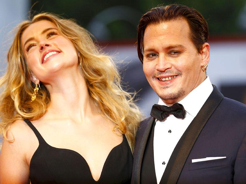 Husband-and-wife team Johnny Depp and Amber Heard hardly ever hit the red carpet together. So when they do, it's kind of a big deal. (AFP, AP Photos)