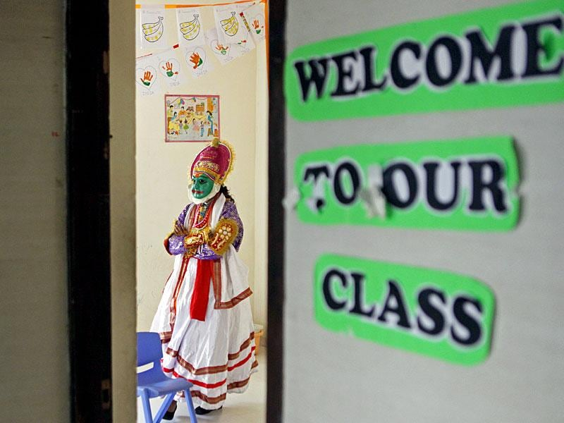 A teacher is dressed a Kathakali dancer for Onam celebrations at RBK Global school in Bhayander, Mumbai. (Pratham Gokhale/HT photo)